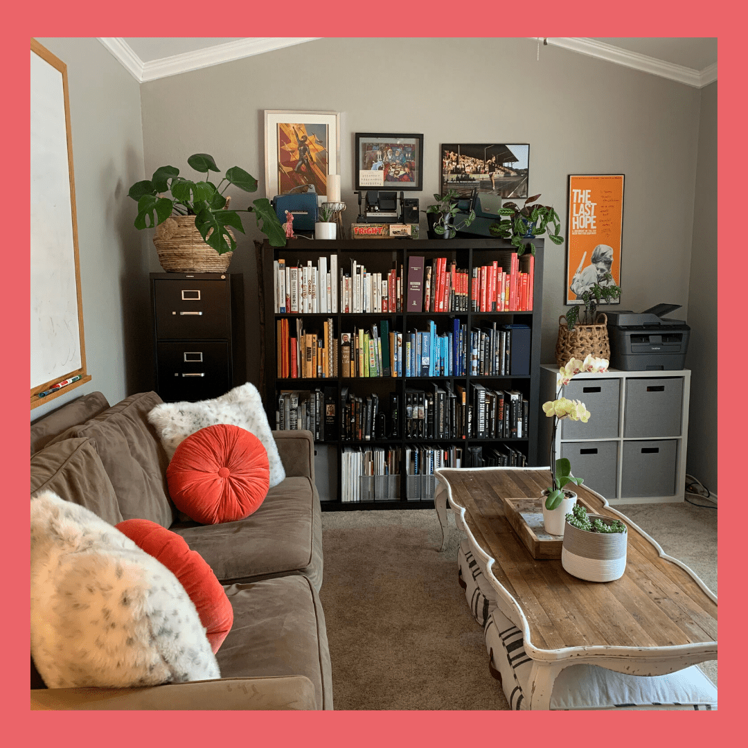 Picture of a living room, with a color coordinated bookshelf