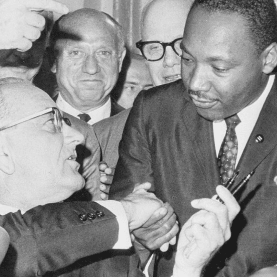 Photo of Martin Luther King Jr. Shaking a man's hand
