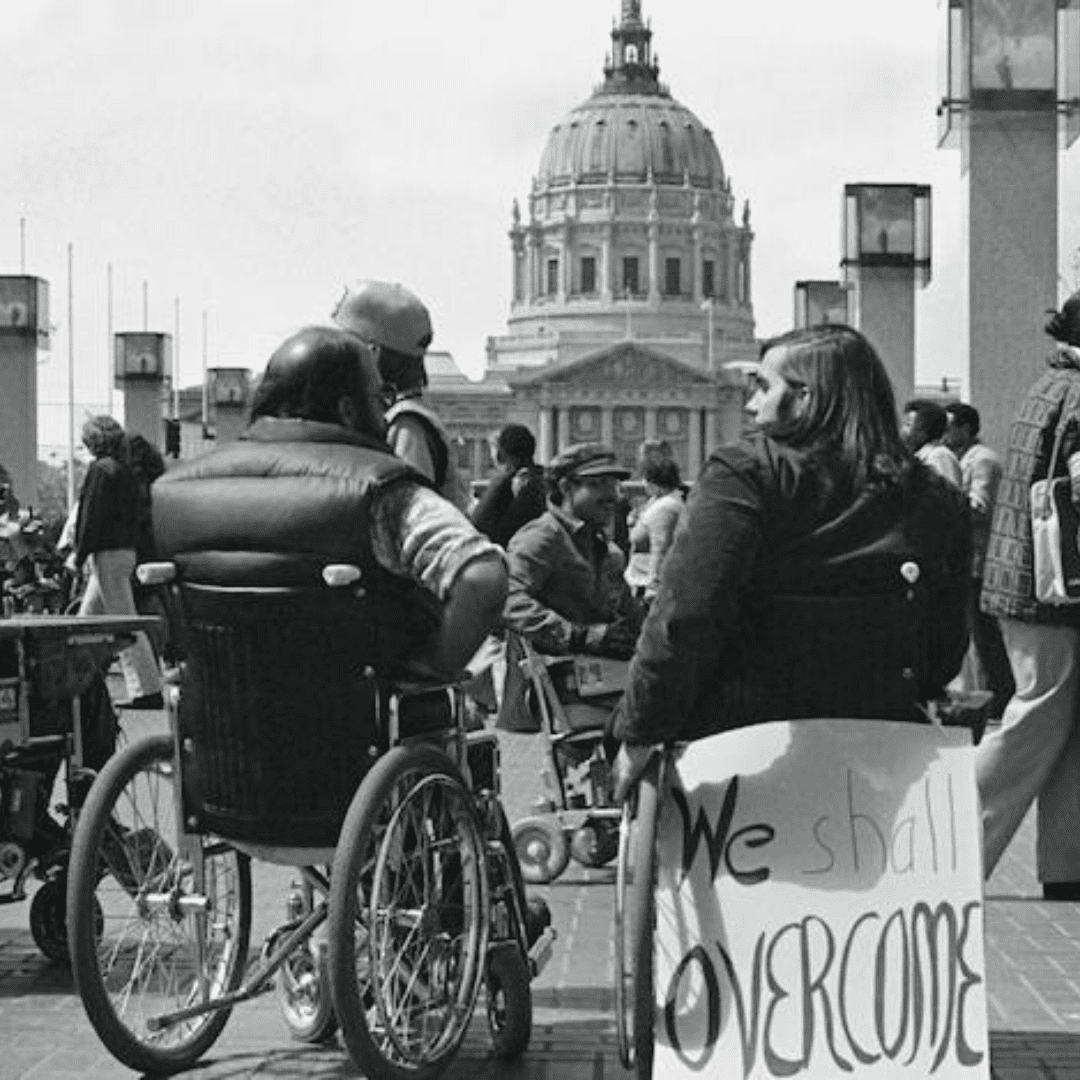 Men in wheelchairs protesting in front of the capital building
