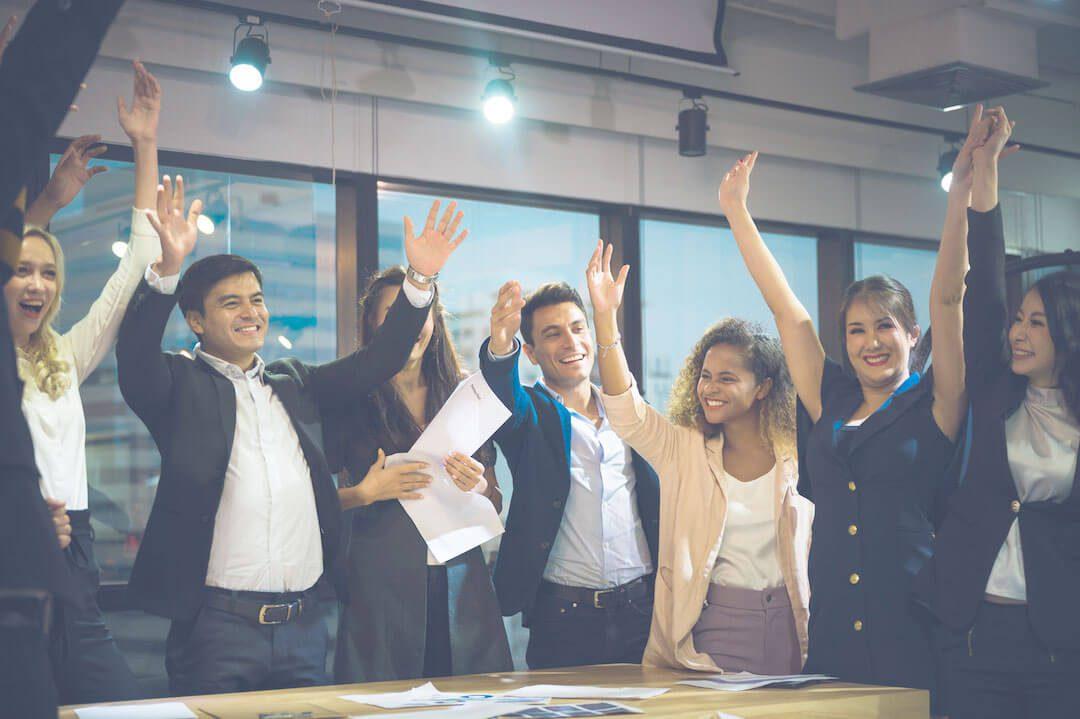 Group of employees celebrating within company